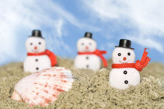Snowmen in the sand Royalty Free Stock Photo