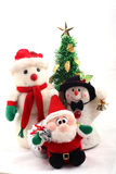 Snowmen, Santa Claus & Christmas Tree. Cute two snowmen and santa claus doll with christmas tree over white background Stock Photos
