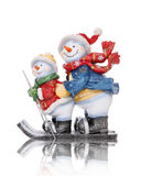 Snowmen Skiing Stock Images