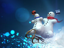 Snowmen on sleds Stock Images