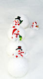 Snowmen and snowballs Royalty Free Stock Photo