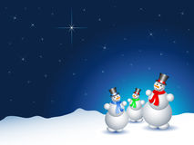 Snowmen on a snowy night. With a starry sky royalty free illustration