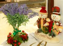 Snowmen toys gifts Christmas interior table decoration cafe bouquet flowers Royalty Free Stock Photography