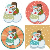 Cute snowmen hugging royalty free stock images