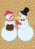Snowmen under the falling snow Stock Images