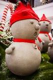Snowmen wearing Santa's hat Royalty Free Stock Photos