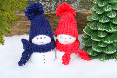 Snowmen in the winter forest Royalty Free Stock Images