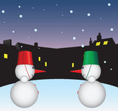 Snowmen in the yard Royalty Free Stock Photos
