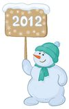 Snowmens boy with sign. Cartoon, snowmen boy with the inscription 2012 Stock Image