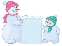 Snowmens com sinal Fotografia de Stock