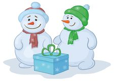 Snowmens with gift box Royalty Free Stock Photo