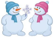 Snowmens with snowy flowers Royalty Free Stock Photography