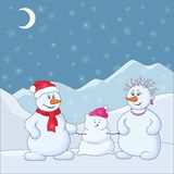 Snowmens in the winter mountains Royalty Free Stock Images
