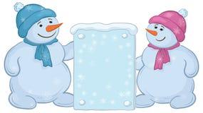 Snowmensjongens met teken Royalty-vrije Stock Afbeeldingen