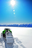 Snowmobile. Against a deep blue sky in Sureanu mountains Romania Stock Photo