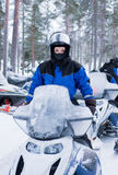 On snowmobile. Teen girl in blue on snowmobile Royalty Free Stock Photo
