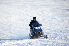 Snowmobile. A snowmobile isolated against a winter snow landscape Stock Photography