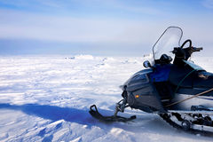 Snowmobile. A snowmobile on a barren winter landscape Royalty Free Stock Images