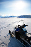 Snowmobile. On a barren winter landscape, Svalbard Norway Royalty Free Stock Images