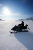 Snowmobile. A snowmobile on frozen ice on a barren winter landscape Stock Photo