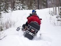 Snowmobile is accelerating in the forest. Sweden lapland in winter. Snowmobile is accelerating in the forest Stock Photo