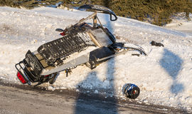 Snowmobile accident, skidoo overturn on snow.  Stock Images