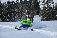Snowmobile in action. In snow  in Surianu mountains Romania Stock Images