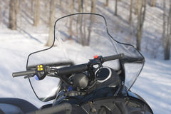 Snowmobile Against Woods Royalty Free Stock Photos