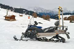 Snowmobile on alps in winter time Royalty Free Stock Photo