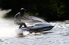 Snowmobile auf Wasser Stockfoto