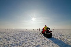 Snowmobile on a beautiful winter landscape Royalty Free Stock Image