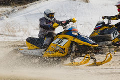 Snowmobile on bend of sport track Royalty Free Stock Images