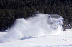Snowmobile blast off. Snowmobile jumping with snow covering the driver Royalty Free Stock Photo