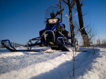 Snowmobile and blue sky Stock Photography