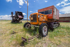 A snowmobile from a bygone age, complete with tracks and skis, rests on the prairie. Stock Photo