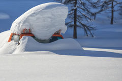 Snowmobile covered by snow Stock Photo