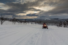 Snowmobile and a dramatic sky Stock Photography
