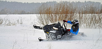 Snowmobile. Driving fast on snowstorm Stock Photos