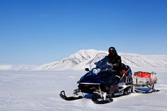 Snowmobile Expedition. A snowmobile on an arctic expedition on a frozen lake Stock Image