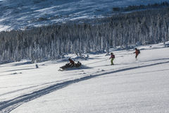 Snowmobile in the forest Stock Image