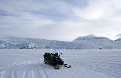 The snowmobile on the frozen fjord. Stock Photography