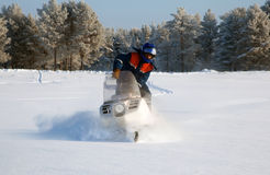 Snowmobile at full speed Stock Image