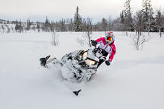 Snowmobile, girl, pink winter, polaris. Snowmobile action image/picture with female driver Royalty Free Stock Photography