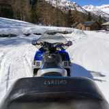 Snowmobile in high mountan with snow Royalty Free Stock Image
