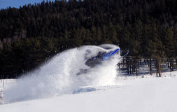 Snowmobile jump Stock Photo