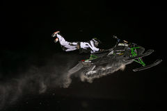 Snowmobile jump. Extreme jumping during night snowmobile competitions at Buttermilk resort in Aspen, Colorado stock images