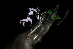 Snowmobile jump. Extreme jumping during night snowmobile competitions at Buttermilk resort in Aspen, Colorado Royalty Free Stock Image