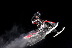 Snowmobile jump. Extreme jumping during night snowmobile competitions at Buttermilk resort in Aspen, Colorado Royalty Free Stock Photos