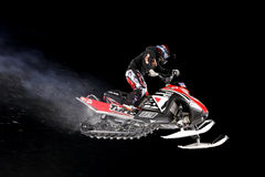 Snowmobile jump. Stock Image