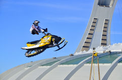 Snowmobile jumping Royalty Free Stock Image